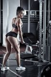 Young lady doing triceps workout Stock Photo