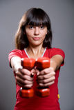 Young lady doing workout with dumbbells Stock Image