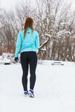 Young lady doing workout in park. Royalty Free Stock Images