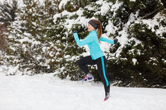 Young lady doing workout in park. Stock Photo