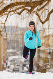 Young lady doing workout in park. Stock Photography