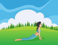 A young lady doing yoga at the hilltop Royalty Free Stock Images