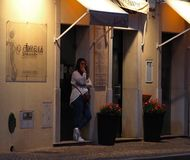 Young Lady In Doorway In Faro Portugal royalty free stock photography