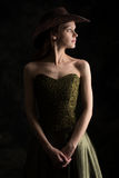 Young lady in a dress and cowboy hat stock image