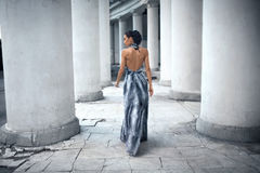 Young lady in dress at the entrance of neoclassical building Stock Images