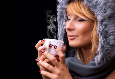 Young lady drinking coffee Stock Photo