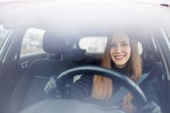 Young lady driving a car in winter royalty free stock photography