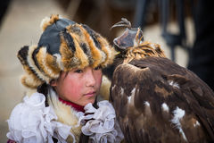 Young lady eagle hunter. BAYAN ULGII, MONGOLIA - CIRCA OCTOBER 2015: young lady eagle hunter with her eage Royalty Free Stock Image