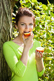 Young lady eating apple Royalty Free Stock Image