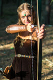 Young lady Elf with a long bow Royalty Free Stock Image