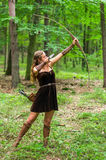 Young lady Elf with a long bow stock photos