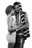 Young lady embrace boyfriend. Young African American lady embrace boyfriend. The guy looking at the camera royalty free stock photography
