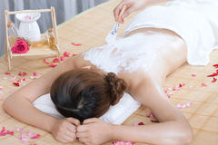 A young lady enjoy body mask in spa salon. Indoors Royalty Free Stock Photos