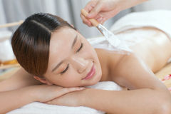 A young lady enjoy body mask in spa salon Stock Image