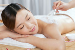 A young lady enjoy body mask in spa salon. Indoors Royalty Free Stock Photo