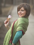 A young lady enjoying an ice cream cone Stock Photos