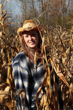 Young lady enjoying nature in a corn field Royalty Free Stock Photos