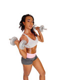 Young lady exercising with dumbbell's. Royalty Free Stock Photos