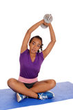 Young lady exercising with dumbbell's. Stock Photography