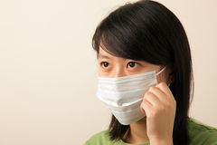 Young lady with face mask. Attractive young lady with a face mask for flu Royalty Free Stock Photo