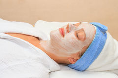 Young lady with facial mask in Royalty Free Stock Photo