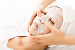 Young lady with Facial mask. At spa Stock Photography