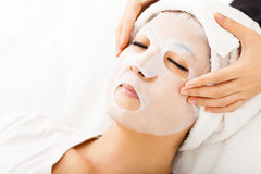 Young lady with Facial mask. At spa Royalty Free Stock Photo