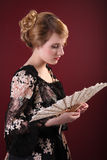 Young lady with fan. Pretty young lady  in old time ball dress with fan Stock Photography