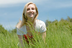 Young lady in the field Stock Photography