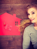 Young lady on floor with home. Royalty Free Stock Photography