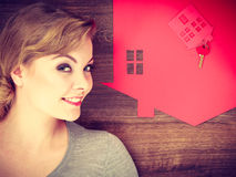 Young lady on floor with home. Royalty Free Stock Images