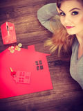 Young lady on floor with home. Royalty Free Stock Photo