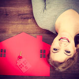 Young lady on floor with home. Stock Photography