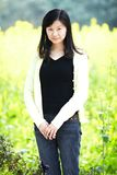 Young lady in  flower fields Royalty Free Stock Images