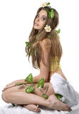 Young lady with flower and leaf  in her hair Stock Photos