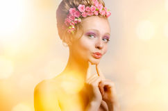 Young lady with flowers Stock Image