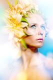 Young lady with flowers Stock Photography