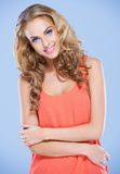 Young lady with folded arms smiling at the camera Royalty Free Stock Photo