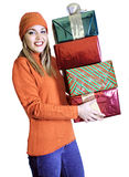 Young Lady With Four Gifts (Christmas / Birthday). Young lady or girl or woman holding four gifts in a stack. Gifts are for all occasions including Christmas and Stock Photos