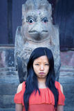 Young Lady in Front of Sculpture Royalty Free Stock Photo