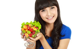Young lady with fruit salad Stock Photos