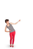 Young lady gesturing with copy space. Beautiful young lady gesturing with copy space Royalty Free Stock Photo
