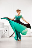 Young  lady in gorgeous dress. Fashion photo. Young redhead woman dancing in gorgeous dress. Fashion photo Stock Photo