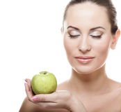 Young lady with green apple Royalty Free Stock Photography
