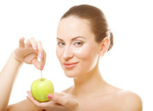 Young lady with green apple Royalty Free Stock Images