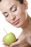 Young lady with green apple Stock Image