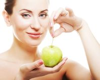 Young lady with green apple Stock Photography