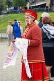 Young lady greets tourists Royalty Free Stock Photo