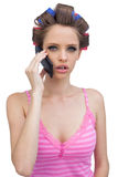 Young lady in hair curlers having a phone call Royalty Free Stock Photo