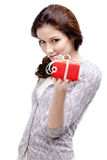 Young lady hands a gift Royalty Free Stock Photos